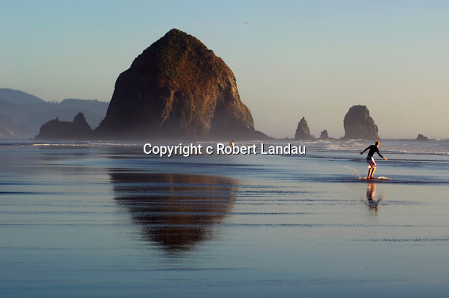 Haystock Rock and skim boarder at Cannon Beach, OR