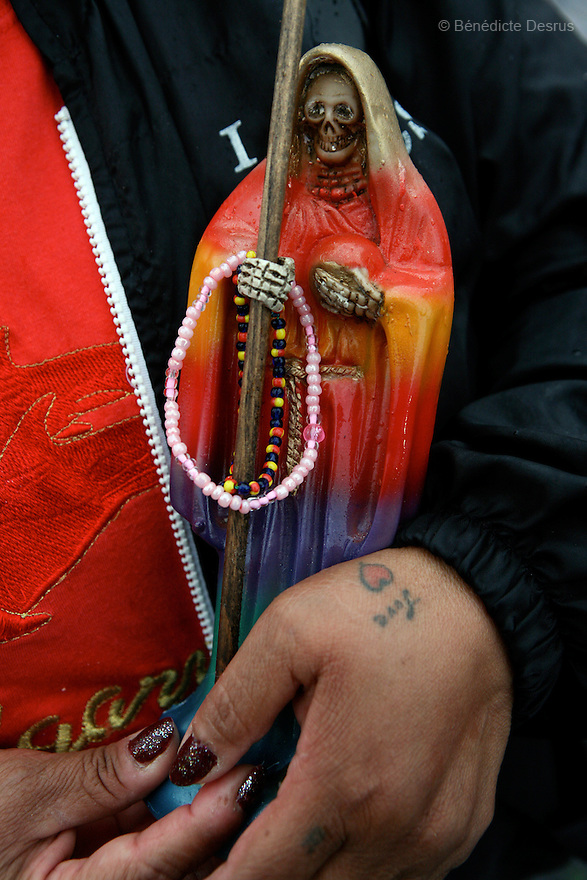 Paola, a resident of Casa Xochiquetzal, goes to bless her Santa Muerte at a local shrine in Mexic City, Mexico on July 1, 2008. Saint Death is a deity or saint-like figure worshiped or venerated in Mexico. The people devoted to this religious icon are praying for a better life. They ask for favors or seek protection, laying offerings of money, cigars and sweets at her bony feet. Casa Xochiquetzal is a shelter for elderly sex workers in Mexico City. It gives the women refuge, food, health services, a space to learn about their human rights and courses to help them rediscover their self-confidence and deal with traumatic aspects of their lives. Casa Xochiquetzal provides a space to age with dignity for a group of vulnerable women who are often invisible to society at large. It is the only such shelter existing in Latin America. Photo by Bénédicte Desrus