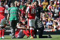 Gabriel Paulista of Arsenal is stretchered off during Arsenal vs Everton, Premier League Football at the Emirates Stadium on 21st May 2017
