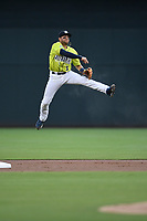 Second baseman Blake Tiberi (3) of the Columbia Fireflies goes airborne to throw out a runner in a game against the Greenville Drive on Friday, May 25, 2018, at Spirit Communications Park in Columbia, South Carolina. Columbia won, 3-1. (Tom Priddy/Four Seam Images)