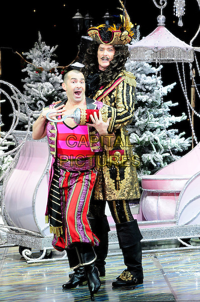 LOUIE SPENCE & DAVID HASSELHOFF .First Family Entertainment theatre company's annual group Pantomime photocall at Piccadilly Theatre, London, England..November 26th, 2010.stage costume panto pantomime full length pink red gold wig captain hook  hands funny mouth open side jacket trousers .CAP/CAS.©Bob Cass/Capital Pictures.