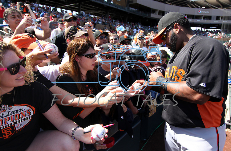 Giant's third baseman Pablo Sandoval signs autographs before the Cactus League preseason game between the San Francisco Giants and the Arizona Diamondbacks in Scottsdale, Ariz., on Sunday, March 4, 2012. The Giants won 11-1..Photo by Cathleen Allison