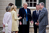 U.S. President Donald Trump, center, speaks as Doug Bradburn, president and chief executive officer of George Washington's Mount Vernon, from right, Emmanuel Macron, France's president, Brigitte Macron, France's first lady, U.S. First Lady Melania Trump and Sarah Miller Coulson, regent with the Mount Vernon Ladies' Association, listen while touring outside the Mansion at the Mount Vernon estate of first U.S. President George Washington in Mount Vernon, Virginia, U.S., on Monday, April 23, 2018. As Macron arrives for the first state visit of Trump's presidency, the U.S. leader is threatening to upend the global trading system with tariffs on China, maybe Europe too. <br /> Credit: Andrew Harrer / Pool via CNP