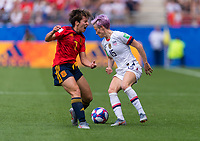REIMS,  - JUNE 24: Marta Corredera #7 is fouled by Megan Rapinoe #15 during a game between NT v Spain and  at Stade Auguste Delaune on June 24, 2019 in Reims, France.
