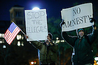 Two people protest against the executive action on immigration policy announced by US President Obama, in New York.  10.21.2014. Eduardo MunozAlvarez/VIEWpress