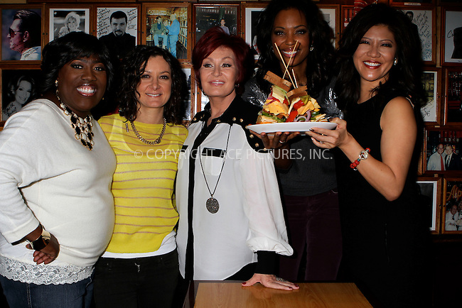 WWW.ACEPIXS.COM . . . . .  ....December 11 2011, New York City....(L-R) Sheryl Underwood, Sara Gilbert, Sharon Osbourne, Aisha Tyler and Julie Chen of CBSÕ 'The Talk' present the TALKwich sandwich at the Carnegie Deli on December 11, 2011 in New York City. ....Please byline: NANCY RIVERA- ACEPIXS.COM.... *** ***..Ace Pictures, Inc:  ..Tel: 646 769 0430..e-mail: info@acepixs.com..web: http://www.acepixs.com