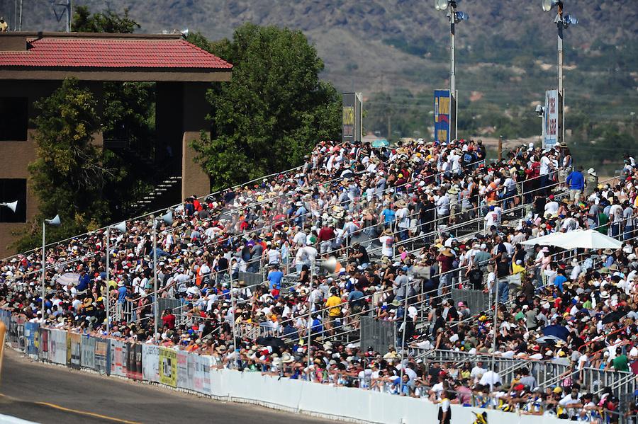 Oct. 15, 2011; Chandler, AZ, USA; NHRA fans in the grandstands during qualifying at the Arizona Nationals at Firebird International Raceway. Mandatory Credit: Mark J. Rebilas-