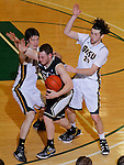 SPEARFISH, SD - FEBRUARY 22, 2014:  Tim Billingsley #34 of UC-Colorado Springs gets fouled in the closing seconds of the second half  of a game against Black Hills State by Riley Ryan #32 and Tommy Earl #23. UC-Colorado Springs won in overtime 100-88. (Photo by Dick Carlson/Inertia)