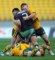 Roos scrumhalf Sam Williams snares the shorts of Siuatonga Likiliki. Rugby League - New Zealand Junior Kiwis v Australian Junior Roos at Westpac Stadium, Wellington, New Zealand on Saturday, 23 October 2010. Photo: Dave Lintott / lintottphoto.co.nz