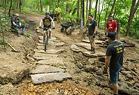 NWA Democrat-Gazette/BEN GOFF @NWABENGOFF<br /> Volunteers with Ozarks Off Road Cyclists add rock armoring Saturday, July 6, 2019, at the intersection of Last Call and Terrapin Station at Kessler Mountain Regional Park in Fayetteville. Volunteers used 11 tons of stone to shore up the often muddy and erosion-damaged section of the trail and recenty completed similar projects on other trails at the park. The Ozark Off Road Cyclists, the local chapter of the International Mountain Bicycling Association, are raising funds through their Kessler Campaign to fund further improvements and future trails at the park.