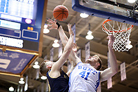 DUKE, NC - FEBRUARY 15: Jack White #41 of Duke University blocks a shot by Dane Goodwin #23 of the University of Notre Dame during a game between Notre Dame and Duke at Cameron Indoor Stadium on February 15, 2020 in Duke, North Carolina.