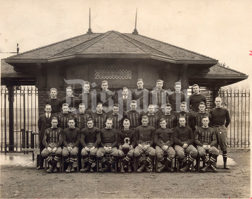 """OHIO FIELD - 1916 - OSU football - Ohio State University - Ohio State football - championship squad . BACK ROW: William E. Cramer , Leon Friedman , A.T. Leonard, Harry Lapp , Bill Daugherty (manager) ; Earl Johnson , Clarence McDonald , Kelly VanDyne and B.E. Sullivan . MIDDLE ROW: L.W. St. John (athletic director); Roy Kirk ; Fred Norton ; Howard Yerges , Chic Harley , Dick Boesel ; Frosty Hurm , Charles Daughters , Virgil Drayer , Gordie Rhodes and Dr. John W. Wilce (coach) ( JACK WILCE ). FRONT ROW: Dwight Peabody ; Howard G. Courtney , Harold J. Courtney , Irwin Turner , Frank """"Swede Sorenson"""" - captain (with ball); Fritz Holtcamp , Charlie Seddon, Robert Karch and Charles Bolen ."""