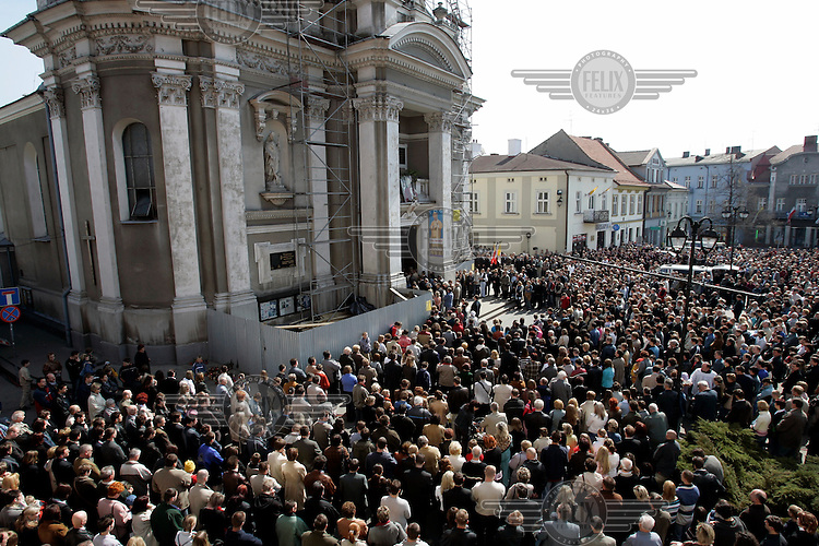 The Catholic faithful gather for a special mass at Wadowice Basilica to mourn Pope John Paul II, who died the previous evening. The Pope was born and brought up in Wadowice.