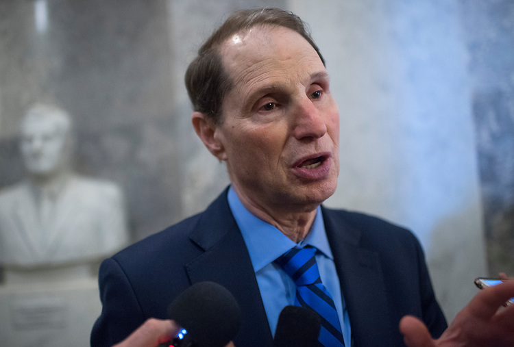 "UNITED STATES - APRIL 6: Sen. Ron Wyden, D-Ore., talks with reporters after a vote in the Senate where they invoked the ""nuclear option"" which allows for a majority vote to confirm a Supreme Court justice nominee, April 6, 2017. The vote for nominee Neil Gorsuch is scheduled for Friday. (Photo By Tom Williams/CQ Roll Call)"