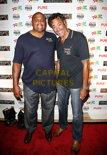CHARLES BARKLEY & BRAD GARRETT.The Ante Up for Africa Celebrity Poker Tournament at the Rio Resort Hotel and Casino, Las Vegas, Nevada, USA..July 2nd, 2009.full length jeans denim blue top grey gray.CAP/ADM/MJT.© MJT/AdMedia/Capital Pictures