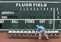 Eric Jarinko, vice president with the Greenville Drive, sets up chairs in preparation for the team photo during the team's media day on April 4, 2012, at Fluor Field at the West End in Greenville, South Carolina. (Tom Priddy/Four Seam Images)
