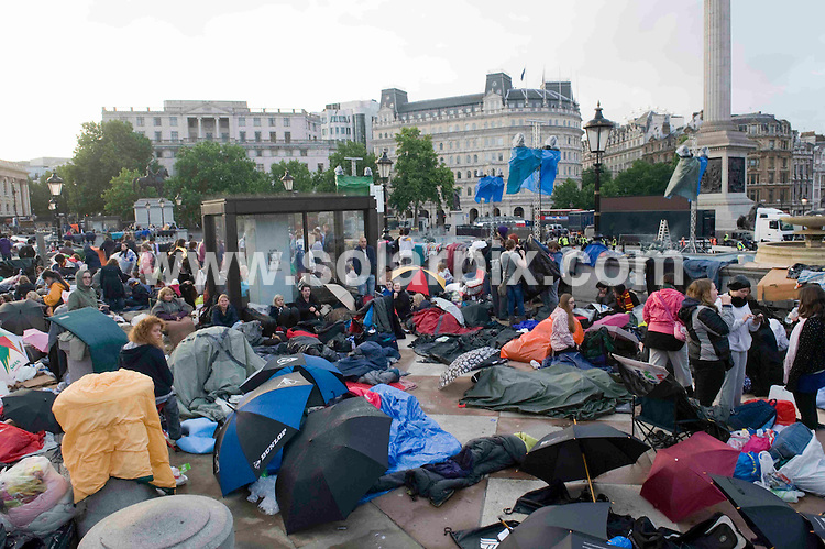 **ALL ROUND PICTURES FROM SOLARPIX.COM**                                             **NO UK NEWSPAPER PUBLICATION**.**UK MAGAZINE & SUPPLEMENT PUBLICATION ONLY** AND NO PUBLICATION IN AUSTRALIA, BELGIUM, FRANCE, GERMANY, ITALY, SCANDINAVIA AND USA**                                                                                  Caption: Harry Potter fans camp out in Trafalgar Square, London,  ahead of Thursday's world premiere of the final Harry Potter movie. London, UK. 6 July 2011                                                                              This pic: Harry Potter fans                                                                                             JOB REF: 13671 SFE       DATE: 06_07_2011                                                           **MUST CREDIT SOLARPIX.COM OR DOUBLE FEE WILL BE CHARGED**                                                                      **MUST AGREE FEE BEFORE ONLINE USAGE**                               **CALL US ON: +34 952 811 768 or LOW RATE FROM UK 0844 617 7637**