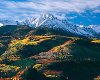 Sunrise on a snow-capped Mount Sneffels on a crisp Autumn morning in the San Juan Mountains, near Telluride, Colorado.