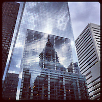 Liberty One reflects in the Comcast Center on a mostly cloudy day in Center City Philadelphia, January 17, 2013.