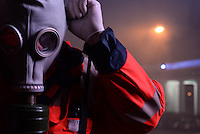 An ambulance man wears a gas mask to protect himself by tear gas fired by the police during  protest against new draconian law to ban protestsacross the country.  Kiev. Ukraine