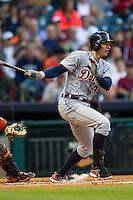 Detroit Tigers outfielder Don Kelly (32) follows through on his swing during the MLB baseball game against the Houston Astros on May 3, 2013 at Minute Maid Park in Houston, Texas. Detroit defeated Houston 4-3. (Andrew Woolley/Four Seam Images).