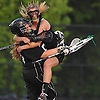 Farmingdale No. 1 Shannon Gaghan gives goalie No. 55 Lindsay Ramos a leaping congratulatory hug after their team's 11-7 win over Massapequa in the Nassau County varsity girls' lacrosse semifinals at Adelphi University on Tuesday, May 19, 2015.<br /> <br /> James Escher
