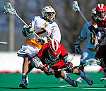 19 March 2011: University of Vermont Catamount Attacker Geoff Worley, a Junior from Coronado, CA, checks Attacker Joe Granata, a Freshman from Lindenhurst, NY, during action against the St. John's University Red Storm at Moulton Winder Field in Burlington, Vermont. The Catamounts defeated the visiting Red Storm 14-9. Mandatory Credit: Ed Wolfstein Photo
