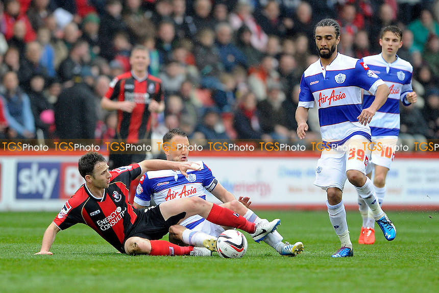 Marc Pugh of AFC Bournemouth and Clint Hill of Queens Park Rangers tangle- AFC Bournemouth vs Queens Park Rangers QPR - Sky Bet Championship Football at the Goldsands Stadium, Bournemouth, Dorset - 05/04/14 - MANDATORY CREDIT: Denis Murphy/TGSPHOTO - Self billing applies where appropriate - 0845 094 6026 - contact@tgsphoto.co.uk - NO UNPAID USE