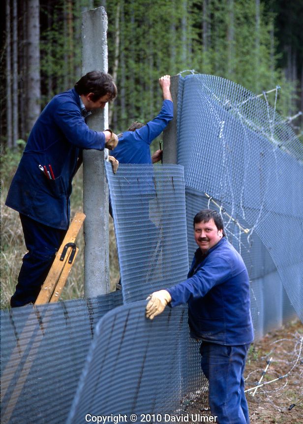Grossburschle, East Germany. Dismantling the fence dividing East from West Germany, May  1990