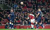Reiss Nelson of Arsenal crosses the ball as Nemanja Radonjic (49) (on loan from Roma) of Crvena Zvezda (Red Star Belgrade) looks on during the UEFA Europa League group stage match between Arsenal and FC Red Star Belgrade at the Emirates Stadium, London, England on 2 November 2017. Photo by Andy Rowland.