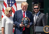 United States President Donald J. Trump, center, poses for a photo with Sherry Pollex, left, and Martin Truex Jr., the NASCAR Cup Series champion, right, during an event on the South Lawn of the White House in Washington, DC on Monday, May 21, 2018.  Truex competes full-time in the Monster Energy NASCAR Cup Series for Furniture Row Racing.  Ms. Pollex is the longtime girlfriend of Truex Jr. who has been battling ovarian cancer since 2014.<br /> Credit: Ron Sachs / CNP