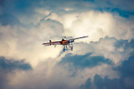 A Bleriot XI high amongst beautiful clouds