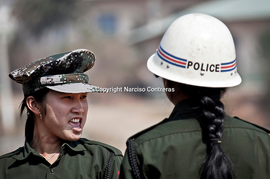 Seng Ra, a cobra female soldier shouts to her camarade during a military training at the KIA base camp outskirsts of Maiya Jang city, the second largest city under control of the Kachin Independence rebel Army. Since the begining of the Kachin uprising for its sovereignty women always fought by side the rebel soldiers, but officially, the female KIA was founded in 2007, since then, up to 1500 women have joint to the rebel army. The KIA is enhancing its troops number since the ceasefire was broken out by the Burmese army last June 2011.