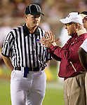 FSU head coach Bobby Bowden has a discussion with the referee in the first half of the Seminoles NCAA football game against the Georgia Tech Yellow Jackets at Doak Campbell Stadium in Tallahassee, Florida October 10, 2009.  Georgia Tech defeated the Seminoles 49-44.   (Mark Wallheiser/TallahasseeStock.com)