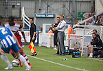 Hartlepool United's manager Colin Cooper (white shirt) watching the first-half action at the Victoria Ground, Hartlepool, during a pre-season friendly between the home team and Middlesbrough. Hartlepool were relegated to League Two at the end of the 2012-13 season whilst their Teesside neighbours remained two divisions above them in the Championship. The game ended in a no-score draw, the home team's goalkeeper Scott Flinders saving a second-half penalty from Boro's Lucas Jutkiewicz, watched by a crowd of 2307.