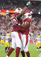 Aug. 28, 2009; Glendale, AZ, USA; Arizona Cardinals running back (26) Beanie Wells is congratulated by defensive end (93) Calais Campbell after scoring a tocuhdown against the Green Bay Packers during a preseason game at University of Phoenix Stadium. Mandatory Credit: Mark J. Rebilas-