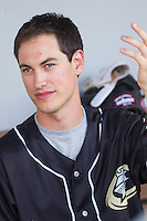 Joey Logano, driver of the #22 Ford Fusion for Team Penske, is interviewed in the dugout prior to the International League game between the Norfolk Tides and the Charlotte Knights at BB&T Ballpark on May 21, 2014 in Charlotte, North Carolina.  (Brian Westerholt/Four Seam Images)