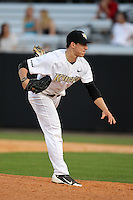 UCF Knights pitcher Joe Rogers #24 delivers a pitch during a game against the Siena Saints at the UCF Baseball Complex on March 3, 2012 in Orlando, Florida.  UCF defeated Siena 6-4.  (Mike Janes/Four Seam Images)