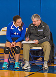 18 October 2015: Yeshiva University Maccabee Setter, Defensive Specialist, and team co-Captain Aliza Muller, a Senior from Los Angeles, CA, gets instruction from Head Coach Joseph Agrest up prior to a game against the College of Mount Saint Vincent Dolphins at the Peter Sharp Center, in Riverdale, NY. The Dolphins defeated the Maccabees 3-0 in the NCAA Division III Women's Volleyball Skyline matchup. Mandatory Credit: Ed Wolfstein Photo *** RAW (NEF) Image File Available ***