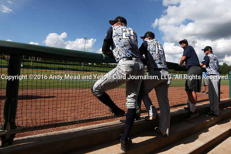 31 May 2016: Nova Southeastern's Cameron Churchill (25) and Kyle Kilbourne (19) wait for the all clear during a lightning delay. The Nova Southeastern University Sharks played the Lander University Bearcats in Game 8 of the 2016 NCAA Division II College World Series  at Coleman Field at the USA Baseball National Training Complex in Cary, North Carolina. Nova Southeastern won the game 12-1.