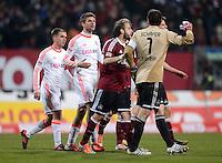 FUSSBALL   1. BUNDESLIGA  SAISON 2012/2013   12. Spieltag 1. FC Nuernberg - FC Bayern Muenchen      17.11.2012 (v. li.) Philipp Lahm , Thomas Mueller (FC Bayern Muenchen) und Torwart Raphael Schaefer (1 FC Nuernberg)