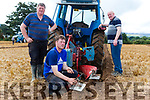 Christy, Richard and Liam Maloney Ballyheigue check their plough at the South Kerry Ploughing Championships in Fossa on Sunday