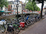 Typically Dutch view of bicycles next to a canal bridge, Leiden, Netherlands