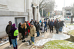 WATERBURY, CT. 21 December 2019-122119BS286 - A large group of people wait in the cold to enter a Christmas Party for the less fortunate and homeless at Basilica of Immaculate Conception in Waterbury on Saturday. Bill Shettle Republican-American
