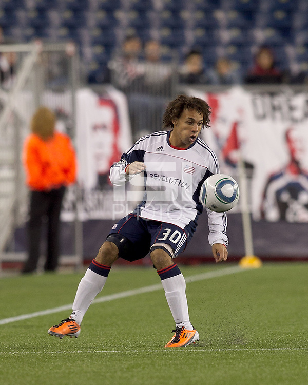 New England Revolution defender Kevin Alston (30) attempts to control the ball. In a Major League Soccer (MLS) match, the New England Revolution tied the Portland Timbers, 1-1, at Gillette Stadium on April 2, 2011.