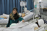 A nurse, working on a ward in Misurata Hospital, adjusts the bedding of a rebel fighter who sustained serious abdominal, head and leg wounds during fighting with forces loyal to Colonel Gaddafi. In February 2011 an armed revolution broke out in Libya and after six months of fighting it appears that Gaddafi's 42 year regime has come to an end while the former dictator is currently on the run....