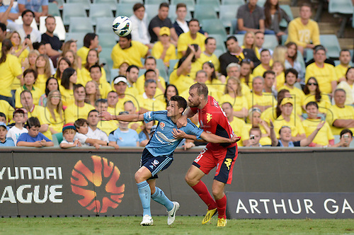 16.02.2013 Sydney, Australia. Sydney midfielder Joel Chianese and Adelaide defender Iain Fyfe during the Hyundai A League game between Sydney FC and Adelaide United from the Allianz Stadium.