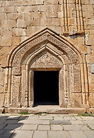 Pictures &amp; images of the Church of the Assumption exterior bas relief Georgian stone work around the doorway,1689, Ananuri castle complex &amp; Georgian Orthodox churches, 17th century, Georgia (country).<br /> <br /> Ananuri castle is situated next to the Military Road overlooking the Aragvi River in Georgia, about 45 miles (72 kilometres) from Tbilisi. It was the castle of the eristavis (Dukes) of Aragvi from the 13th century and was the scene of numerous battles. In 2007 Ananuri castle was enscribed on the   UNESCO World Heritage Site tentative list.<br /> <br /> The exterior of The Church of the Assumption is highly decorated with Georgian bas relief sculpture. It main portal has intricate geometric Georgian relief stone work and in its triangular tympanum are intricate stone carvings with Christ in a mondorla at its centre, and carvings of angels amongst  intricate foliage stone carvings.