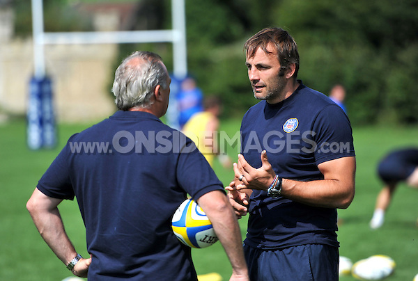 Academy Director Danny Grewcock speaks to Bath Director of Rugby Gary Gold. Bath Rugby training session on August 27, 2013 at Farleigh House in Bath, England. Photo by: Patrick Khachfe/Onside Images