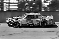 BROOKLYN, MI - AUGUST 11: Dale Earnhardt drives his damaged Richard Childress Chevrolet during the Champion Spark Plug 400 NASCAR Winston Cup race at the Michigan International Speedway near Brooklyn, Michigan, on August 11, 1985.